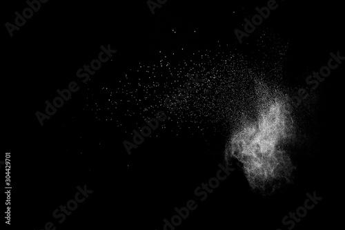 White powder explosion cloud against black background.White dust particles splash. - 304429701