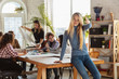 Women's rights and equality at the office. Caucasian businesswomen or young confident model pointing on in front of coworkers having meeting about problem in workplace, male pressure and harassment.
