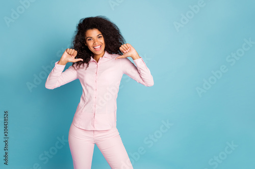 Who is best. Me. Photo of amazing dark skin wavy lady indicating fingers on herself advertising own personality wear pink shirt trousers isolated blue color background