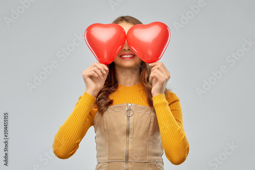 valentine's day, love and people concept - smiling young teenage girl with red h Wallpaper Mural