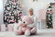 Young Beautiful Girl With Pink Bear