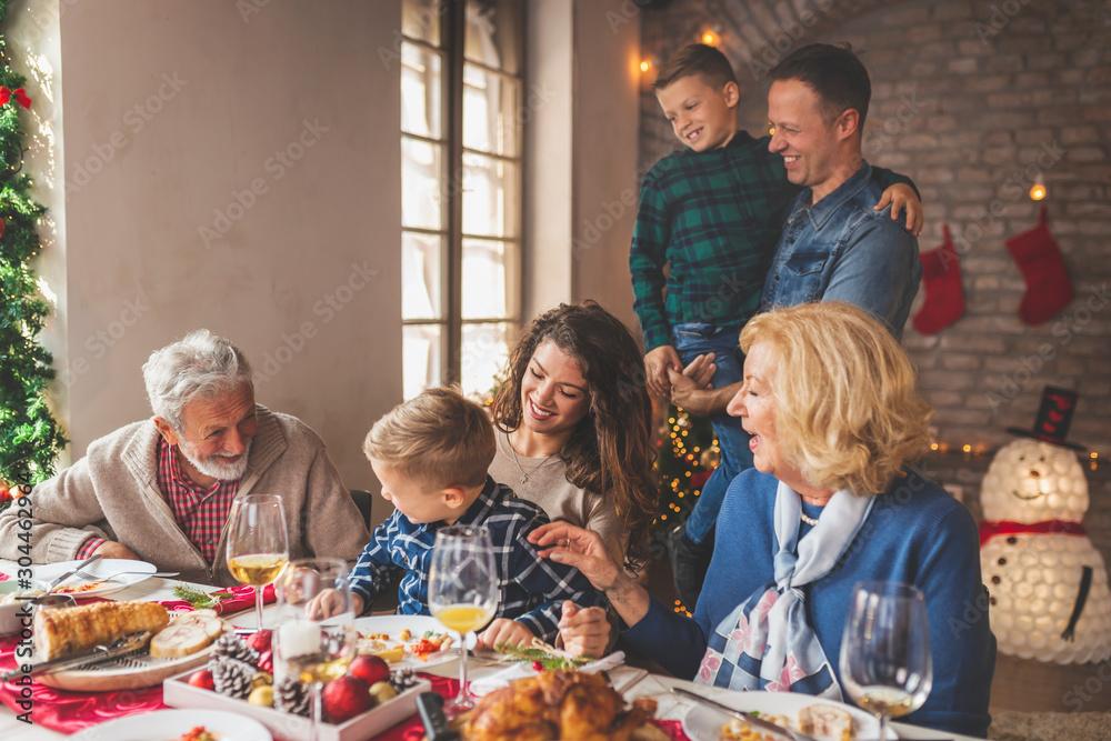Fototapeta Family having Christmas dinner