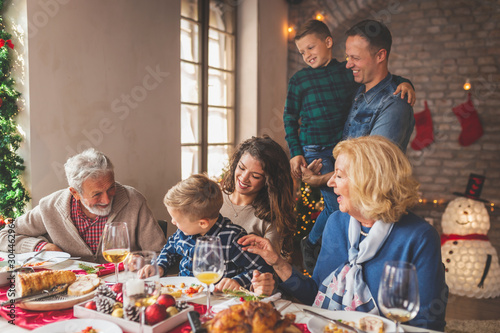 Family having Christmas dinner Canvas Print