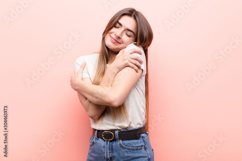 Cuadros en Lienzo young pretty woman feeling in love, smiling, cuddling and hugging self, staying