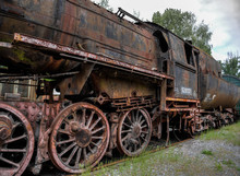 Dilapidated, Rusty And Abandoned Steam Locomotive