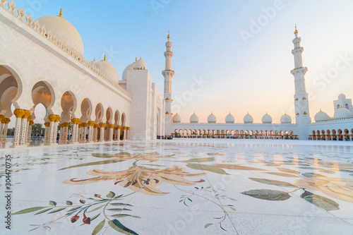 Panoramic view of Sheikh Zayed Grand Mosque, Abu Dhabi, United Arab Emirates. The third biggest mosque in the world. Blue sky sunny day.