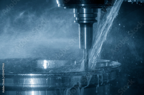 Fotomural  The CNC milling center cutting the alloy wheel by solid ball endmill tool with coolant method