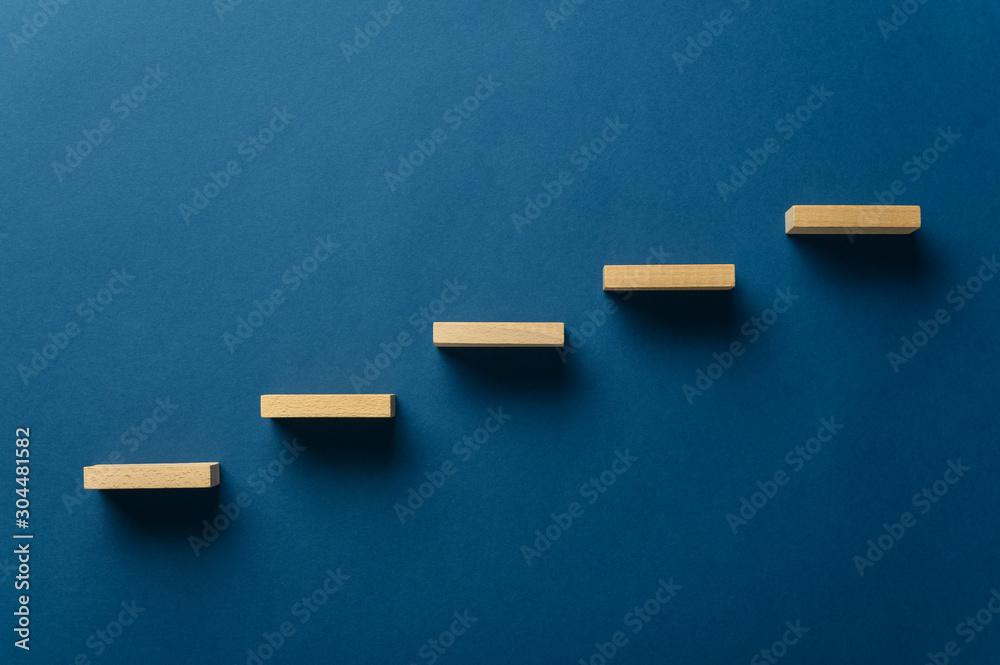 Fototapeta Wooden pegs forming a stairway
