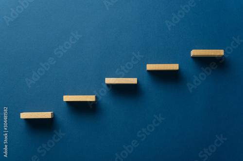 Fotografie, Tablou Wooden pegs forming a stairway