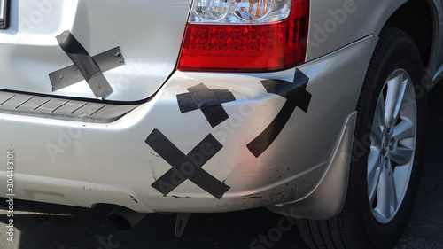 Obraz na plátně A car has its damage covered by whimsical bandages, taking the scratches with hu