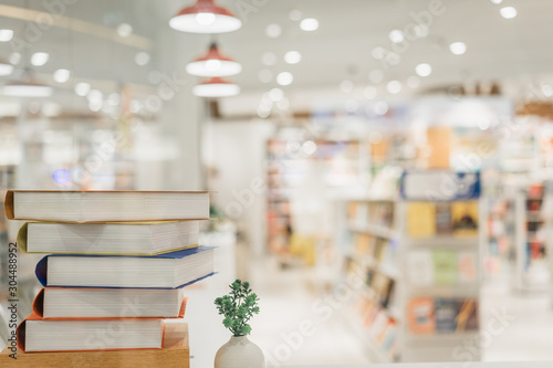 Fotografija  Book stack in the library room and blurred bookshelf background for business, education and back to school concept