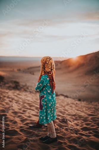 Nomad girls at sunrise in the desert of Morocco Wallpaper Mural