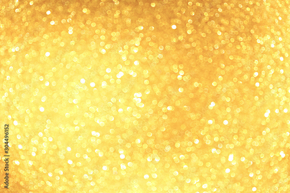 Fototapeta Golden sparkle glitters with bokeh effect and selectieve focus. Festive background with bright gold lights, champagne bubble. Christmas mood concept. Copy space, close up, texture, top view.