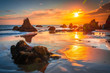 canvas print picture - Beautiful and Colouful Orange Sunset beach of California with Rocks