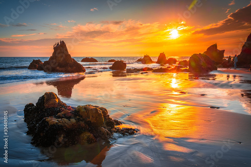plakat Beautiful and Colouful Orange Sunset beach of California with Rocks
