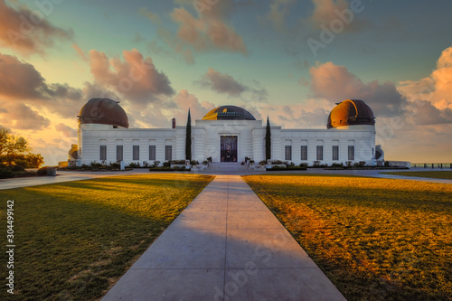 Landscape view of Griffith observatory in Los Angeles with dramatic colorful sky Wallpaper Mural