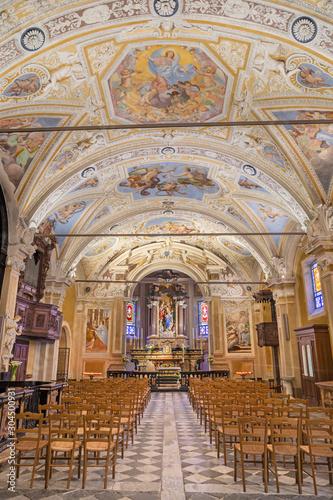 OSSUCCIO, ITALY - MAY 8, 2015: The nave of baroque church Sacro Monte della Beata Vergine del Soccorso with the frescoes by Salvatore Pozzi di Puria (1595 – 1681).