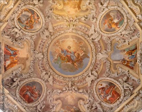 RIVA DEL GARDA, ITALY - JUNE 13, 2019: The ceiling fresco of Assumption of Virgin Mary in the cupola of church Chiesa di Santa Maria Assunta (Cappella del Suffragio) by Teofilo Polacco (19 cent.).