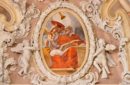 RIVA DEL GARDA, ITALY - JUNE 13, 2019: The baroque fresco of St. Jerome doctor of the west catholic church in church Chiesa di Santa Maria Assunta by Teofilo Polacco from beginn of 19. cent..