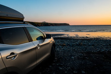 View Of Car Parked On Beach