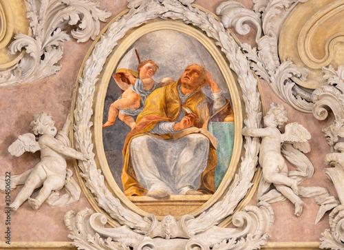 RIVA DEL GARDA, ITALY - JUNE 13, 2019: The baroque fresco of St. Augustine doctor of the west catholic church in church Chiesa di Santa Maria Assunta by Teofilo Polacco from beginn of 19. cent..