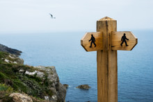 Wooden Signpost On Hiking Trail Along Pembrokeshire Coast