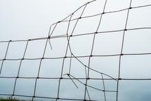 Close Up Of Broken Mesh Fence