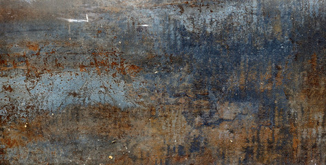 rusty metal surface with red, black and orange tones - worn steampunk backgro...