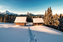 Wooden Huts In Winter Mountain...