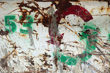 White Rusty Metal Surface With Scratches And Painted With Green Spray The Recycling Symbol And A Number 53