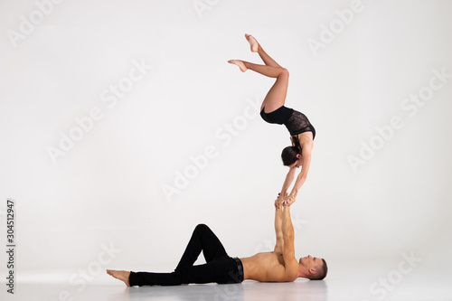 Duo Of Acrobats Showing hand to hand Trick, Isolated On White Canvas Print