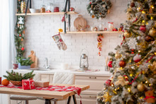 Kitchen Decorated With Pine Garlands And Christmas Toys.