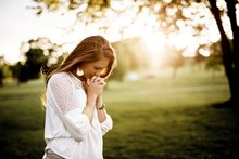 Closeup Shot Of A Female Prayi...