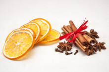 Christmas Composition - Dried Orange, Anise, Cinnamon, Cloves. On Wooden Background