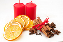 Christmas Composition – Candles, Dried Orange, Anise, Cinnamon, Cloves. On Wooden Background
