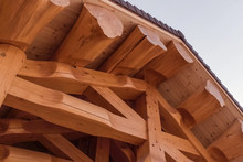 Details And Elements Of Wooden House Made Of Timber. The Constru