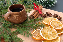 Christmas Composition – Coffee, Dried Orange, Anise, Cinnamon. On Wooden Background.