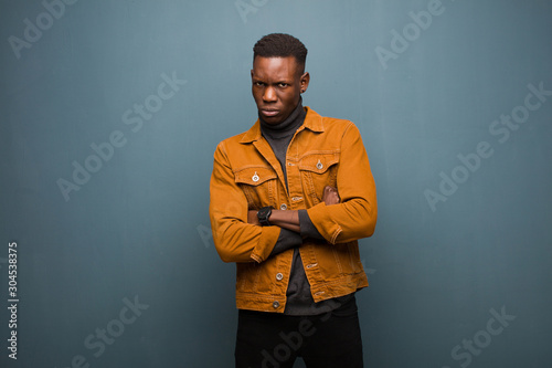 Photo young african american black man feeling displeased and disappointed, looking se