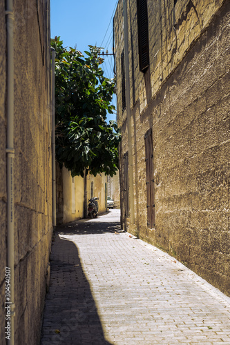 Canvas Prints Narrow alley Valletta Malta, July 16 2019. Traditional Maltese architecture in Valletta Old Town in Malta, street with traditional balconies and old buildings in historical city of Malta.