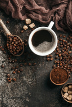 Coffee Board With Coffee Beans On Dark Textured Background.
