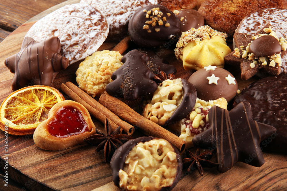 Fototapety, obrazy: Mixed Christmas cookies. Colorful mix of Christmas-themed decorated cookies on table