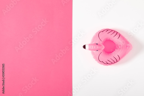 Summer beach composition. pink inflatable mini flamingo on pastel  pink background, pool float party, trendy summer concept. Flat lay, top view, copy space - 304553165
