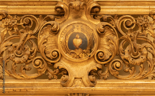 CATANIA, ITALY - APRIL 7, 2018: The baroque carved decoration in church Chiesa di San Domenico with the heart in the center.