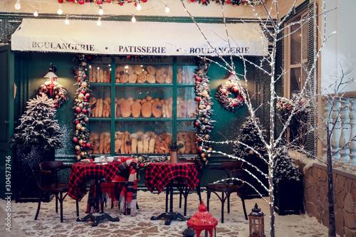 Stampa su Tela Cozy outdoor cafe on Christmas eve