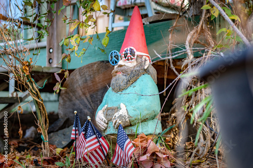 Colorful hippie gnome statue standing in a garden in Southern Oregon Wallpaper Mural