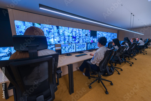 Female security operator working in a security  data control room offices Canvas Print
