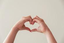 Child Hands Making Heart Shape...