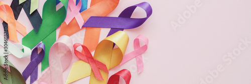 Obraz colorful ribbons on pink panoramic banner background, cancer awareness, World cancer day - fototapety do salonu