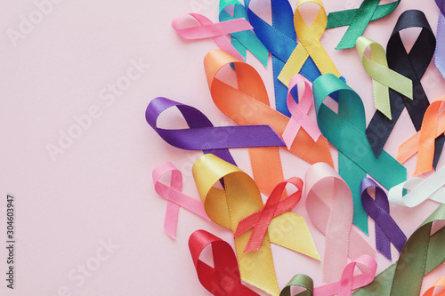 Fotobehang Vrouw gezicht colorful ribbons on pink background, cancer awareness, World cancer day