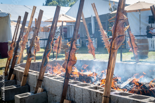 Photo Salmon being  grilled over an open fire using a traditional native american tech